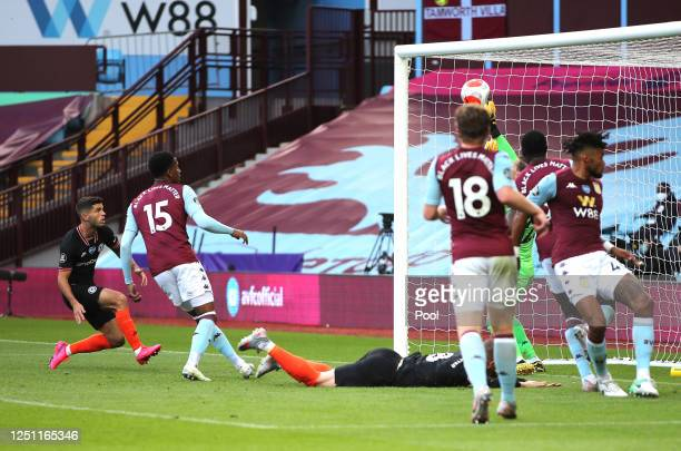 Christian Pulisic of Chelsea scores his teams first goal during the Premier League match between Aston Villa and Chelsea FC at Villa Park on June 21...