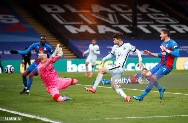Christian Pulisic of Chelsea scores their team's fourth goal past Vicente Guaita of Crystal Palace during the Premier League match between Crystal...