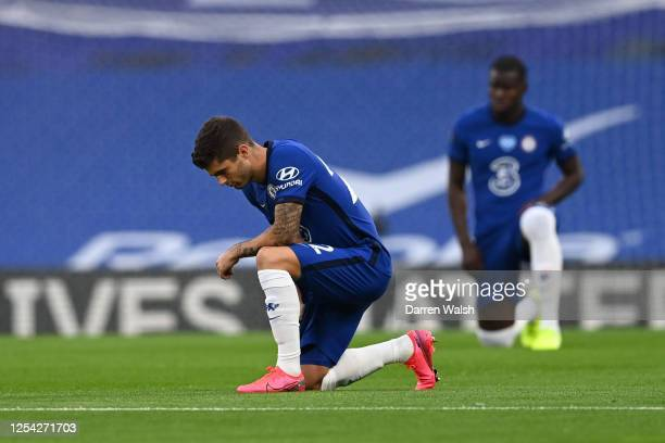 Christian Pulisic of Chelsea takes a knee in support of the Black Lives Matter movement ahead of the Premier League match between Chelsea FC and...