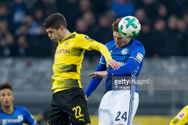 Christian Pulisic of Dortmund and Bastian Oczipka of Schalke battle for the ball during the Bundesliga match between Borussia Dortmund and FC Schalke...