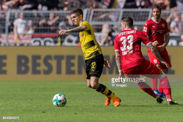 Christian Pulisic of Dortmund and Daniel Ginczek of Stuttgart battle for the ball during the Bundesliga match between Borussia Dortmund and VfB...