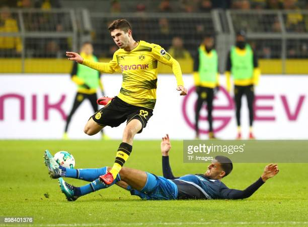 Christian Pulisic of Dortmund and Florian Grillitsch of Hoffenheim battle for the ball during the Bundesliga match between Borussia Dortmund and TSG...