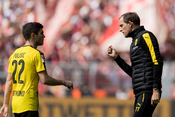 Christian Pulisic of Dortmund and Head coach Thomas Tuchel of Dortmund , gestures during the Bundesliga match between Borussia Dortmund and FC Koeln...