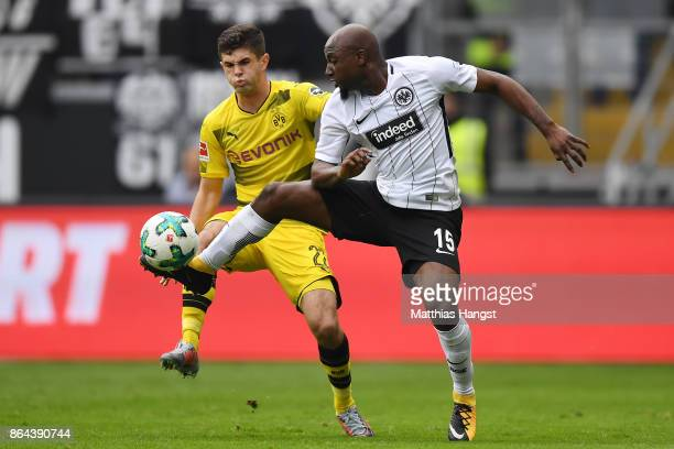 Christian Pulisic of Dortmund and Jetro Willems of Frankfurt fight for the ball during the Bundesliga match between Eintracht Frankfurt and Borussia...