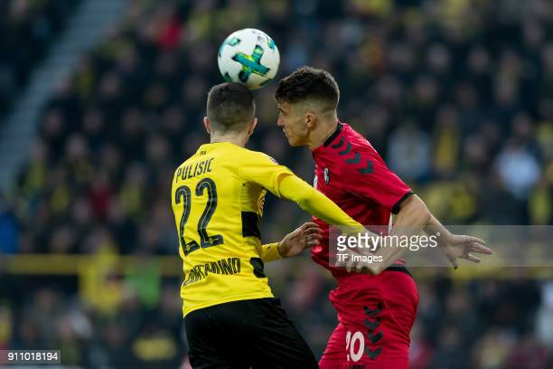 Christian Pulisic of Dortmund and Marc Oliver Kempf of Freiburg battle for the ball during the Bundesliga match between Borussia Dortmund and...