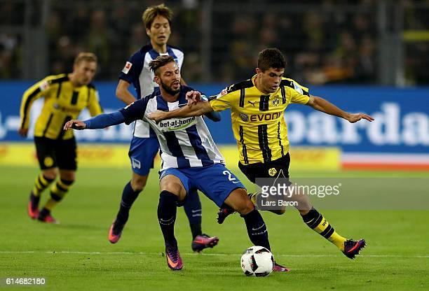 Christian Pulisic of Dortmund and Marvin Plattenhardt of Berlin battle for the ball during the Bundesliga match between Borussia Dortmund and Hertha...