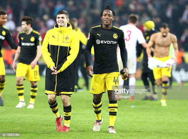 Christian Pulisic of Dortmund and Michy Batshuayi of Dortmund celebrate after winning the Bundesliga match between 1 FC Koeln and Borussia Dortmund...