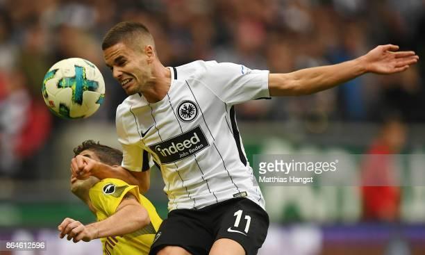 Christian Pulisic of Dortmund and Mijat Gacinovic of Frankfurt fight for the ball during the Bundesliga match between Eintracht Frankfurt and...