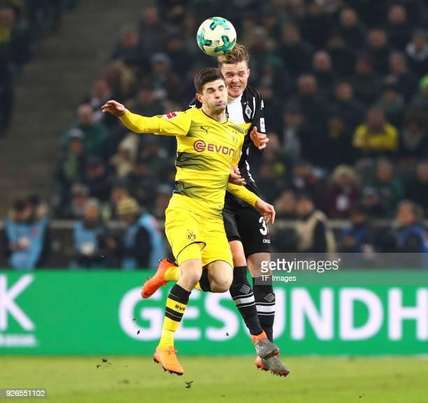 Christian Pulisic of Dortmund and Nico Elvedi of Moenchengladbach battle for the ball during the Bundesliga match between Borussia Moenchengladbach...
