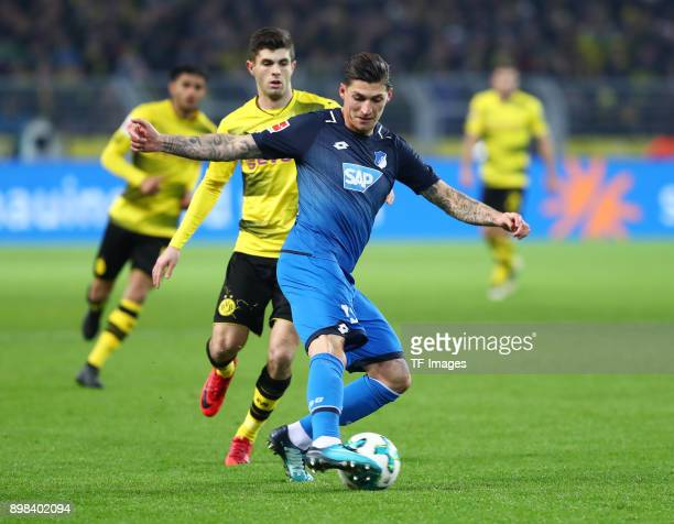 Christian Pulisic of Dortmund and Steven Zuber of Hoffenheim battle for the ball during the Bundesliga match between Borussia Dortmund and TSG 1899...