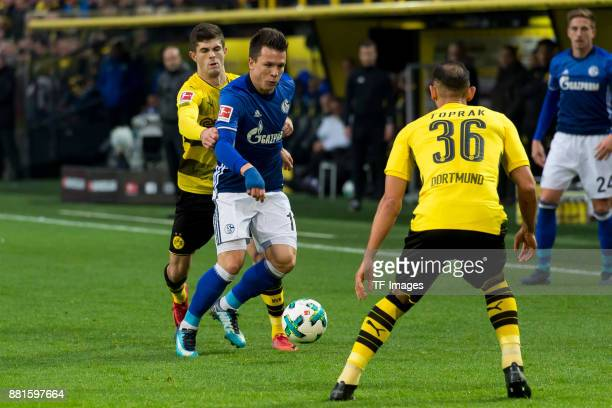 Christian Pulisic of Dortmund and Yevhen Konoplyanka of Schalke battle for the ball during the Bundesliga match between Borussia Dortmund and FC...