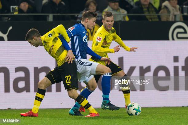 Christian Pulisic of Dortmund Bastian Oczipka of Schalke and Andrey Yarmolenko of Dortmund battle for the ball during the Bundesliga match between...