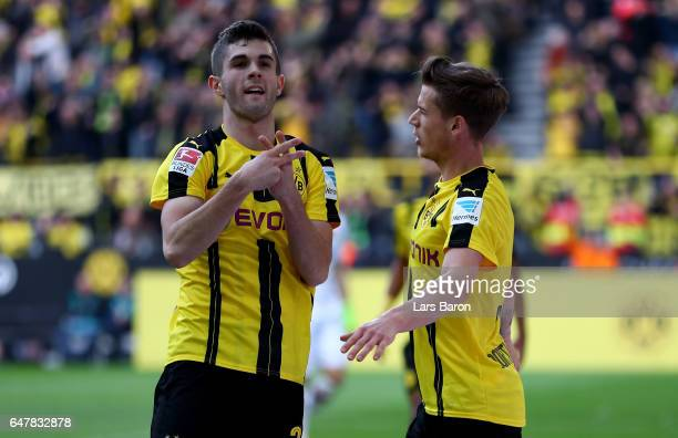 Christian Pulisic of Dortmund celebrates after scoring his teams fourth goal during the Bundesliga match between Borussia Dortmund and Bayer 04...