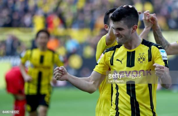 Christian Pulisic of Dortmund celebrates after scoring his teams fourth goal during the Bundesliga match between Borussia Dortmund and Bayer 04...