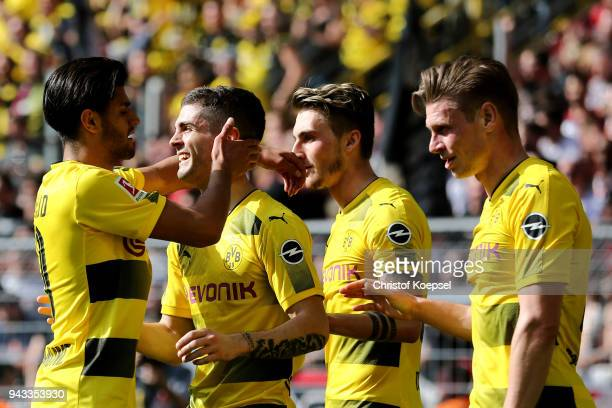 Christian Pulisic of Dortmund celebrates the first goal with Mahmoud Dahoud of Dortmund during the Bundesliga match between Borussia Dortmund and VfB...