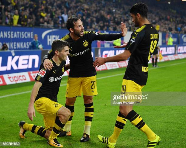 Christian Pulisic of Dortmund celebrates with Gonzalo Castro of Dortmund and Mahmoud Dahoud of Dortmund after he scored his teams third goal to make...