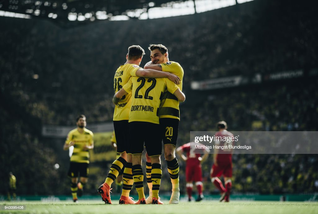 Christian Pulisic of Dortmund celebrates with his team-mates after scoring his team's first goal during the Bundesliga match between Borussia Dortmund and VfB Stuttgart at Signal Iduna Park on April 8, 2018 in Dortmund, Germany.
