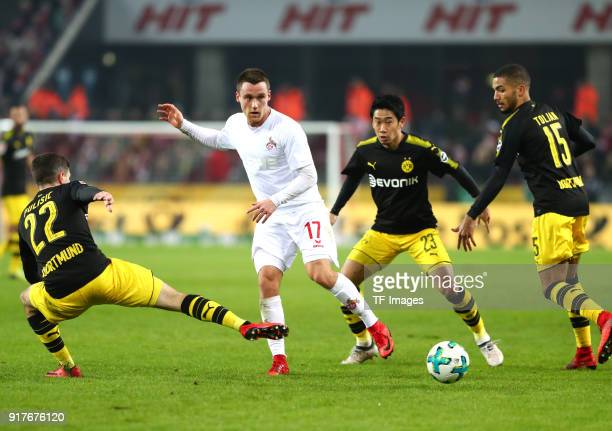 Christian Pulisic of Dortmund Christian Clemens of Koeln Shinji Kagawa of Dortmund and Jeremy Toljan of Dortmund battle for the ball during the...
