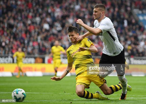 Christian Pulisic of Dortmund fighgts for the ball with Ante Rebic of Frankfurt during the Bundesliga match between Eintracht Frankfurt and Borussia...