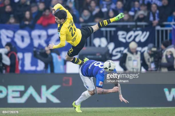 Christian Pulisic of Dortmund is challenged by Jerome Gondorf of Darmstadt during the Bundesliga match between SV Darmstadt 98 and Borussia Dortmund...