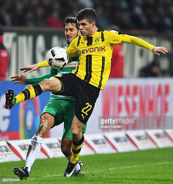 Christian Pulisic of Dortmund is challenged by Santiago Garcia of Bremen during the Bundesliga match between Werder Bremen and Borussia Dortmund at...