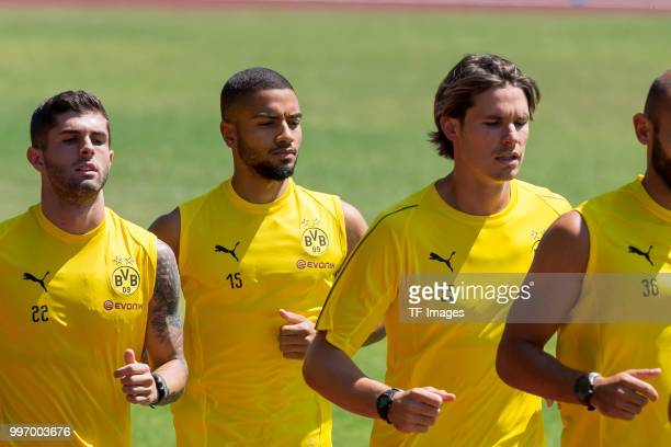 Christian Pulisic of Dortmund Jeremy Toljan of Dortmund and Goalkeeper Marwin Hitz of Dortmund run during a training session on July 7 2018 in...