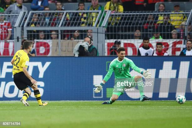 Christian Pulisic of Dortmund scores his team's first goal past goalkeeper Sven Ulreich of Muenchen during the DFL Supercup 2017 match between...