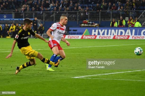 Christian Pulisic of Dortmund scores his teams third goal to make it 30 during the Bundesliga match between Hamburger SV and Borussia Dortmund at...