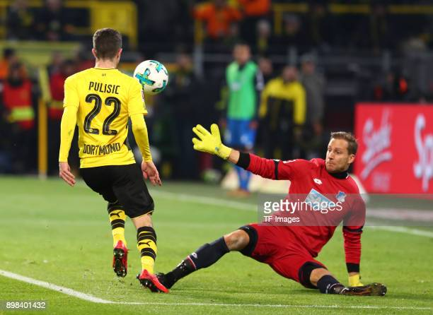 Christian Pulisic of Dortmund scores the team`s second goal and Goalkeeper Oliver Baumann of Hoffenheim in action during the Bundesliga match between...