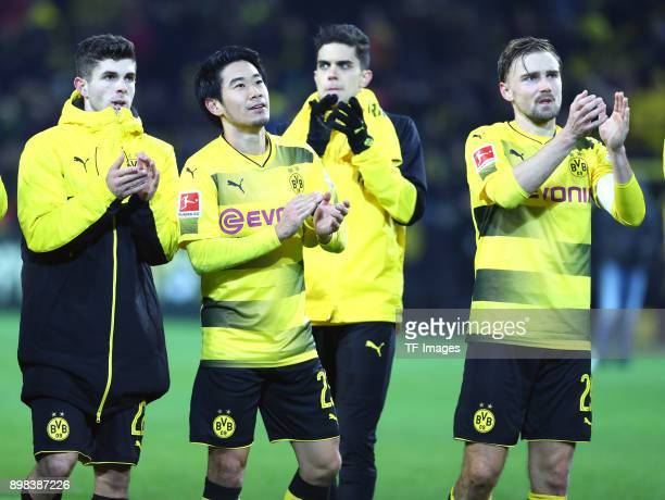Christian Pulisic of Dortmund Shinji Kagawa of Dortmund Marc Bartra Aregall of Dortmund and Marcel Schmelzer of Dortmund celebrate after winning the...
