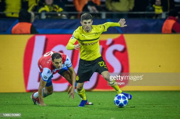Christian Pulisic of Dortmund Sofyan Amrabat of Bruegge battle for the ball during the Group A match of the UEFA Champions League between Borussia...