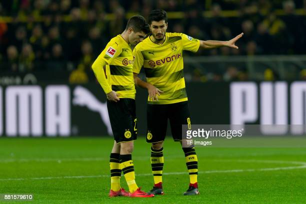 Christian Pulisic of Dortmund speaks with Nuri Sahin of Dortmund during the Bundesliga match between Borussia Dortmund and FC Schalke 04 at Signal...