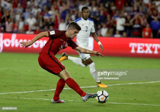 Christian Pulisic of the United States attempts a shot on goal during the final round qualifying match against Panama for the 2018 FIFA World Cup at...
