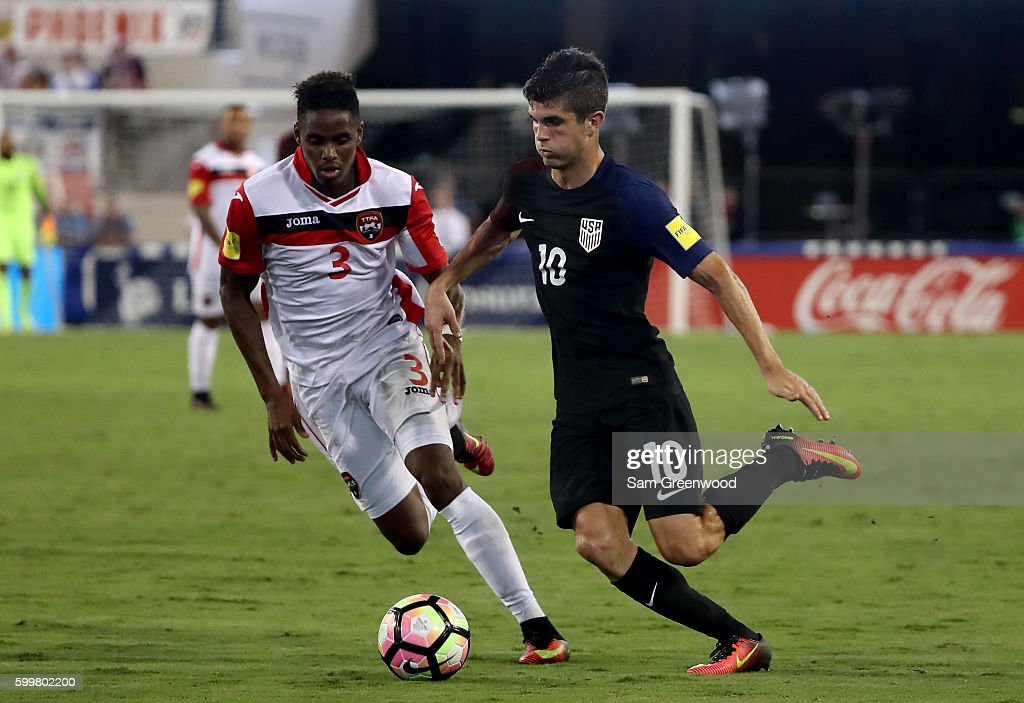 Christian Pulisic #10 of the United States drives past Joevin Jones #3 of Trinidad & Tobago during the FIFA 2018 World Cup Qualifier at EverBank Field on September 6, 2016 in Jacksonville, Florida.