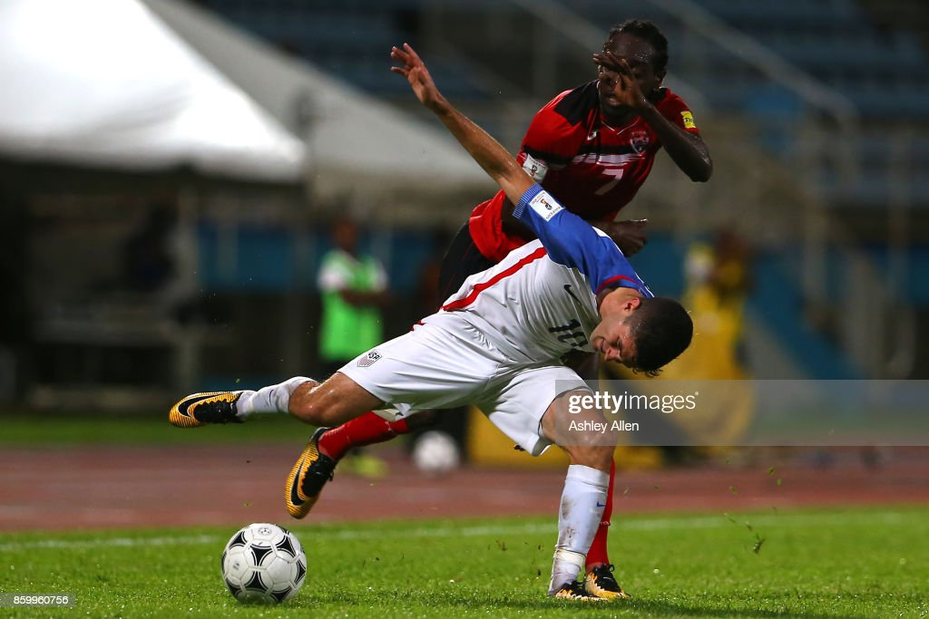 Christian Pulisic (10) of the United States mens national team battles for control of the ball with Nathan Lewis (7) of Trinidad and Tobago during the FIFA World Cup Qualifier match between Trinidad and Tobago at the Ato Boldon Stadium on October 10, 2017 in Couva, Trinidad And Tobago.