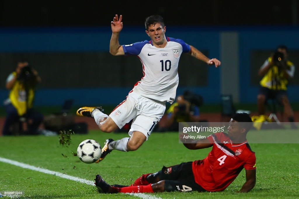 Christian Pulisic (L) of the United States mens national team is tackled by Kevon Villaroel (R) of Trinidad and Tobago during the FIFA World Cup Qualifier match between Trinidad and Tobago at the Ato Boldon Stadium on October 10, 2017 in Couva, Trinidad And Tobago.