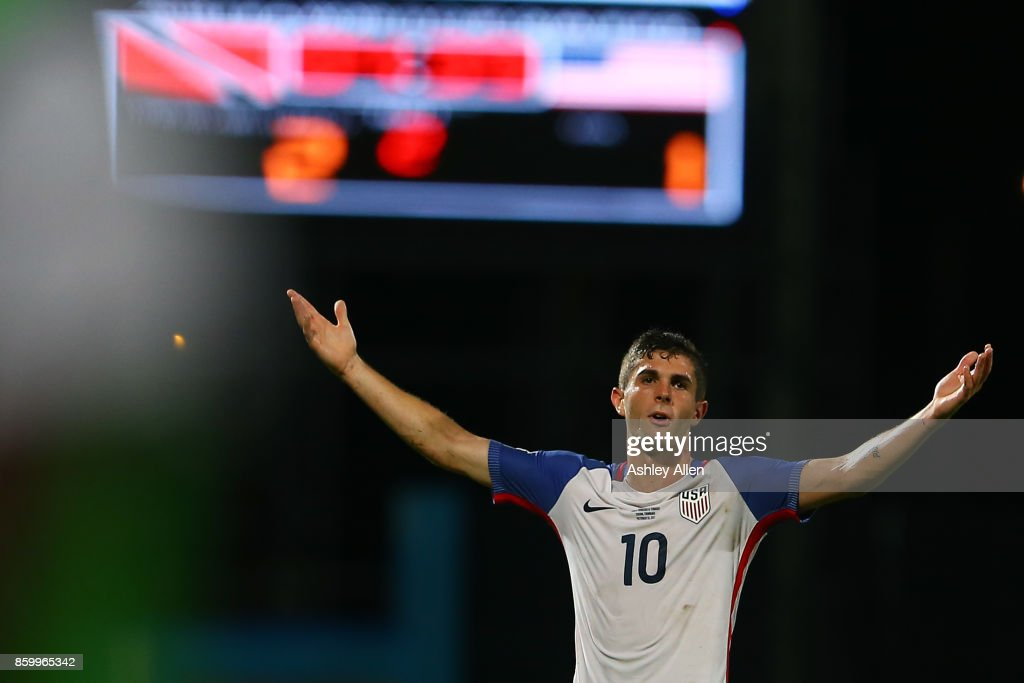 Christian Pulisic of the United States mens national team reacts to the referee's call during the FIFA World Cup Qualifier match between Trinidad and Tobago at the Ato Boldon Stadium on October 10, 2017 in Couva, Trinidad And Tobago.