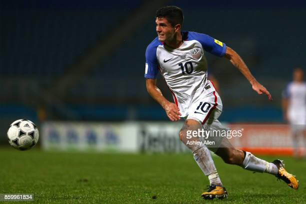 Christian Pulisic of the United States mens national team runs with the ball during the FIFA World Cup Qualifier match between Trinidad and Tobago at...