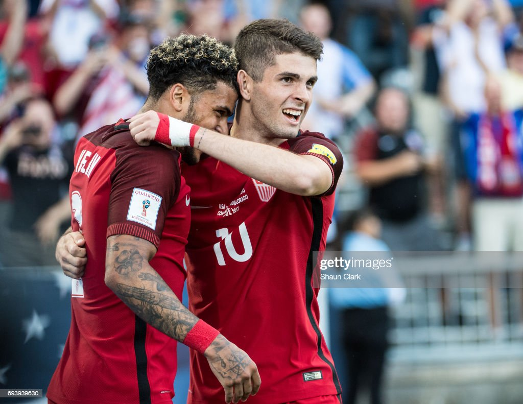 Christian Pulisic #10 of United States celebrates his first goal with DeAndre Yedlin #2 of United States during the World Cup Qualifier match between the United States and Trinidad & Tobago at Dick's Sporting Goods Park on June 8, 2017 in Commerce City, Colorado. The United States won the match 2-0