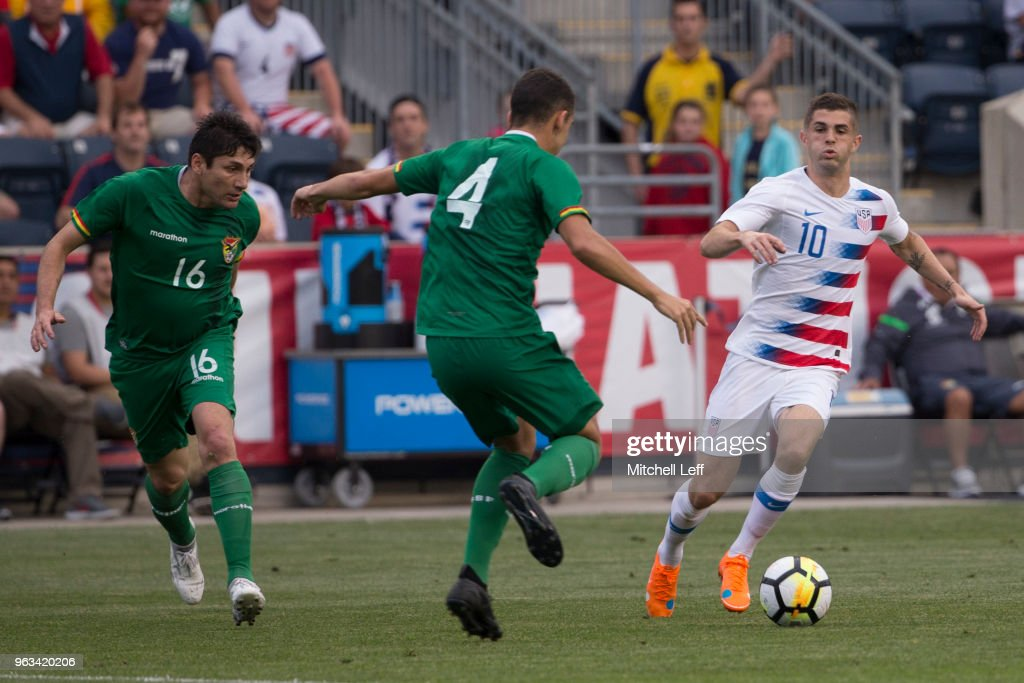 Christian Pulisic #10 of United States controls the ball against Ronald Raldes #16 and Luis Haquin #4 of Bolivia in the first half of the friendly soccer match at Talen Energy Stadium on May 28, 2018 in Chester, Pennsylvania. The United States defeated Bolivia 3-0.