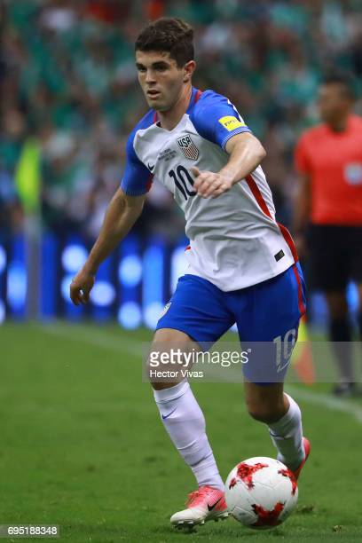 Christian Pulisic of United States drives the ball during the match between Mexico and United States as part of the FIFA 2018 World Cup Qualifiers at...