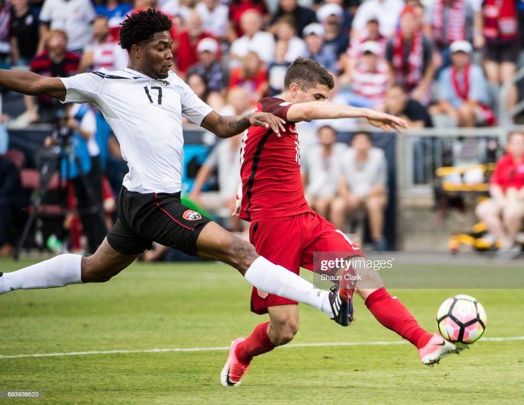 Christian Pulisic #10 of United States takes a shot as Mekell Williams #17 of Trinidad & Tobago defends during the World Cup Qualifier match between the United States and Trinidad & Tobago at Dick's Sporting Goods Park on June 8, 2017 in Commerce City, Colorado. The United States won the match 2-0