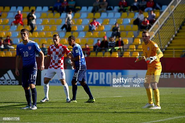 Christian Pulisic of USA and team mate Will Pulisic look on during the FIFA U17 Men's World Cup 2015 group A match between USA and Croatia at Estadio...