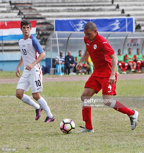 Christian Pulisic of USA in action against Yasmany Lopez of Cuba during the friendly match between Cuba and USA at Estadio Pedro Marrero in Havana...