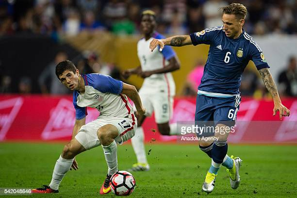 Christian Pulisic of USA struggle for the ball against Lucas Biglia of Argentina during the 2016 Copa America Centenario Semifinal match between USA...
