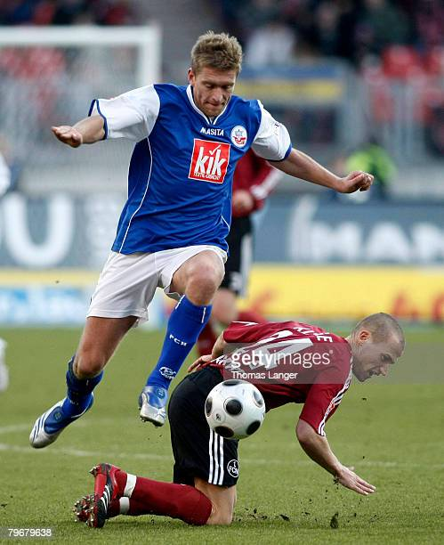 Christian Rahn of Rostock and Peer Kluge of Nuremberg in action during the Bundesliga match between 1.FC Nuremberg and Hansa Rostock at the...