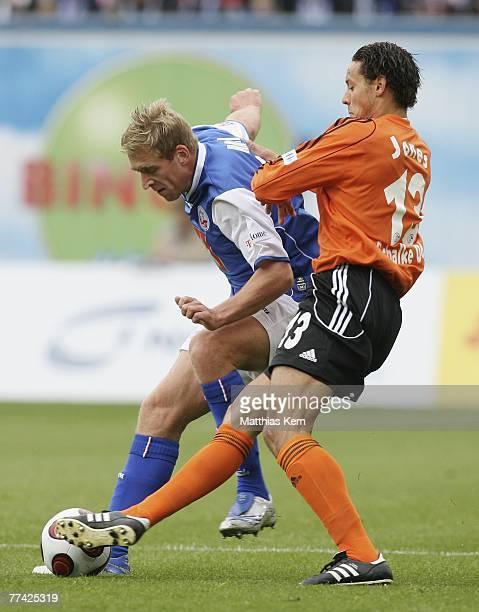 Christian Rahn of Rostock battles for the ball with Jermaine Jones of Schalke during the Bundesliga match between FC Hansa Rostock and FC Schalke 04...