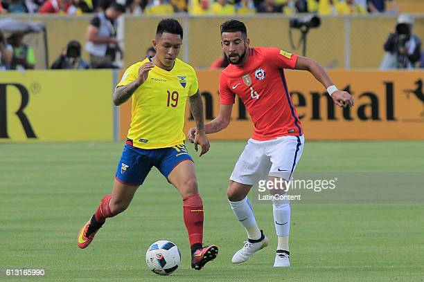 Christian Ramirez of Ecuador fights for the ball with Mauricio Isla of Chile during a match between Ecuador and Chile as part of FIFA 2018 World Cup...