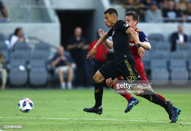 Christian Ramirez of Los Angeles FC challenges Nick Besler of Real Salt Lake for the ball during the first half of their MLS match at Banc of...
