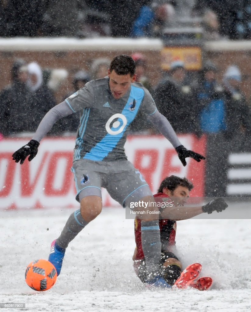 Christian Ramirez #21 of Minnesota United FC controls the ball against Michael Parkhurst #3 of Atlanta United FC during the second half of the match on March 12, 2017 at TCF Bank Stadium in Minneapolis, Minnesota. Atlanta defeated Minnesota 6-1.